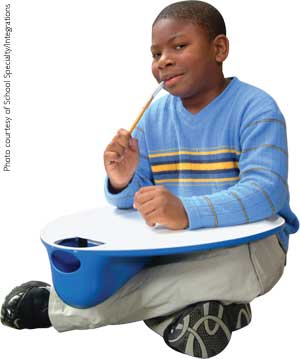 Child with lap desk and pencil topper